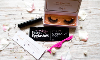 faux mink eyelashes in a case with eyelash glue and eyelash applicator