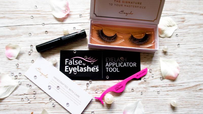 faux mink eyelashes in a case with eyelash glue and eyelash applicator