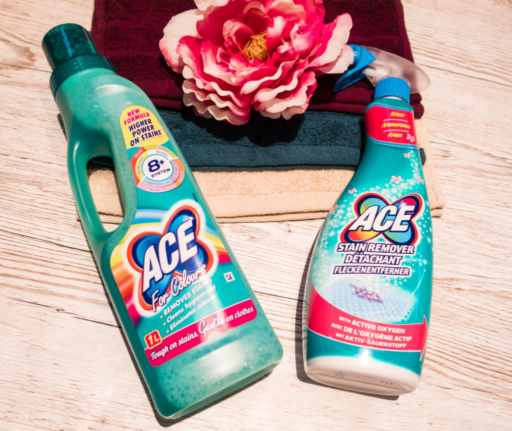 ACE for colours and ACE stain remover together next to some pretty face cloths in  plum, jade and cream