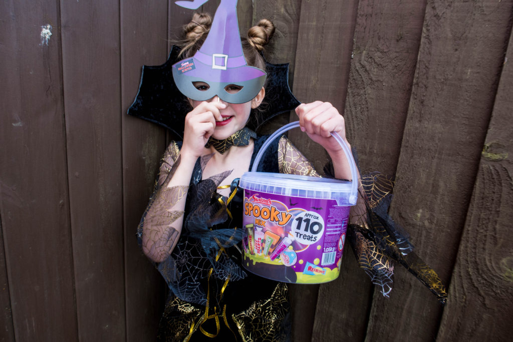 halloweensorted Emma with a witches hat and bucket of sweets