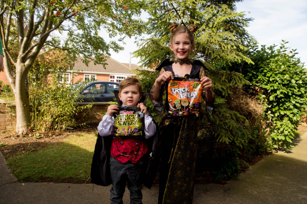 halloweensorted kids in vampire costumes holding bags of swizzels sweets