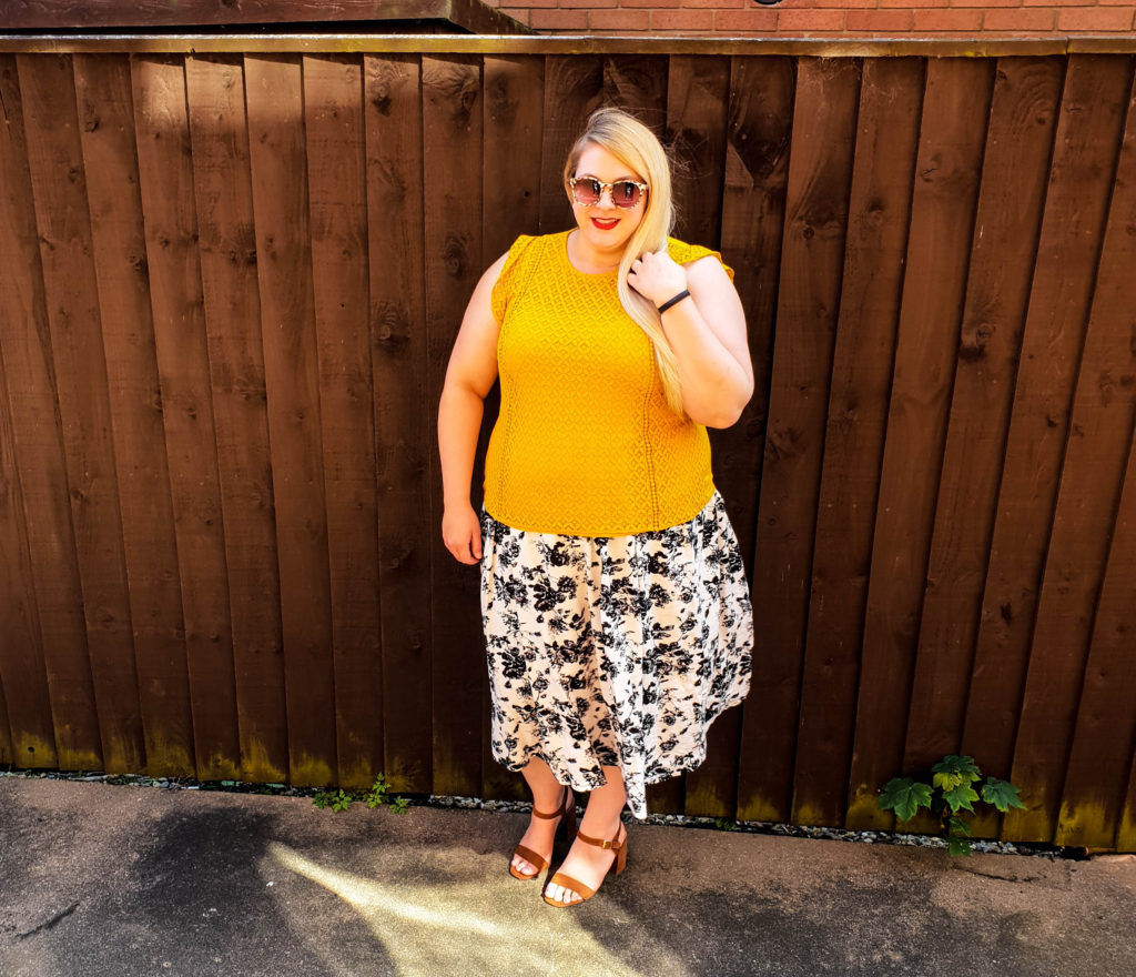 Before picture of me looking pretty fat in my garden near a fence. I lost 10lb in my first two weeks at Slimming World