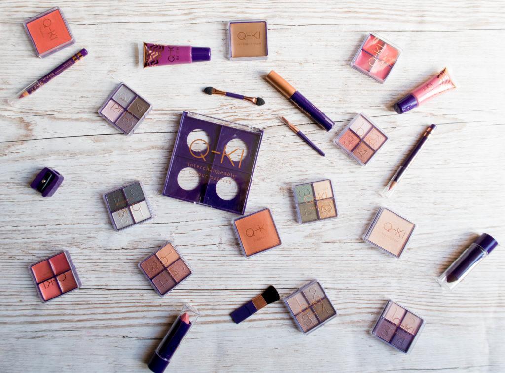 contents of Q-Ki affordable beauty advent calendar including eyeshadow, mascara, lip glosses