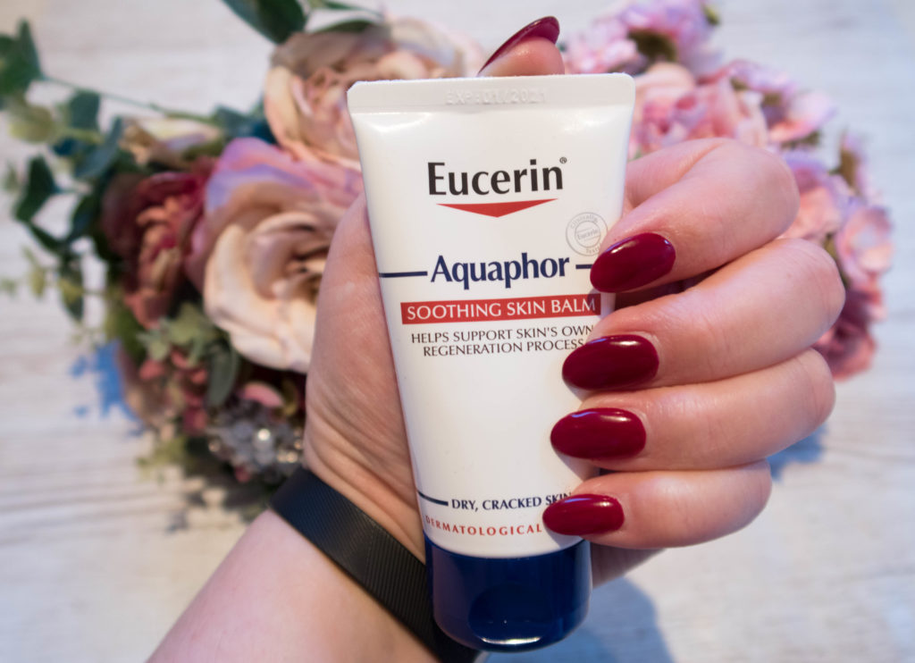 My freshly manicured hand holding the Aquaphoe tube for the #MyAquaphor Challenge