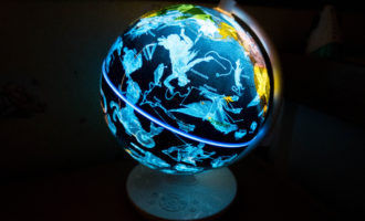 Smart Globe Myth by Oregon Scientific. Picture of globe illuminated in a dark room