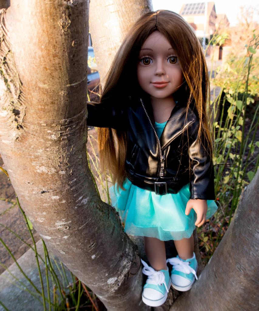 I'M A GIRLY fashion doll in a tree