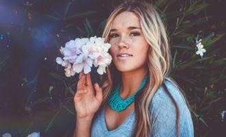 girl in light blue holding flower near faceRevamp Your Wardrobe