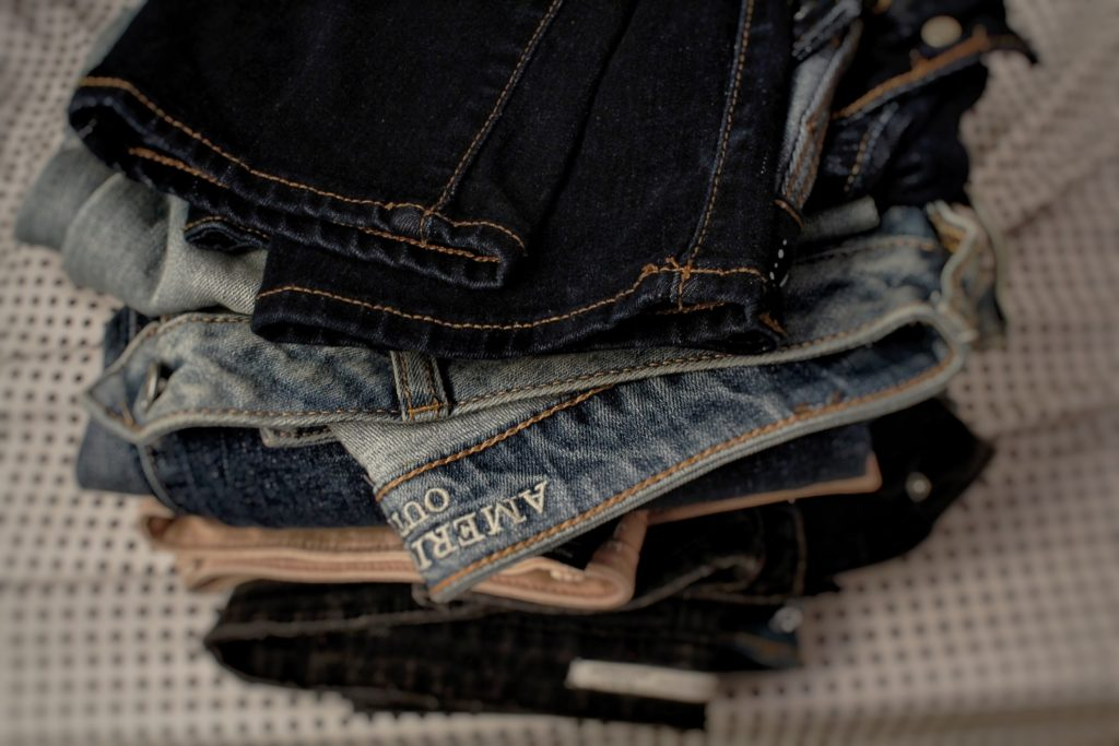 pile of jeans Revamp Your Wardrobe