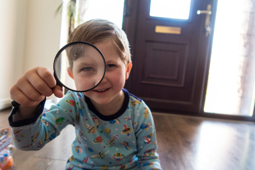 Smashers season 3 Gregory looking through a magnifying glass
