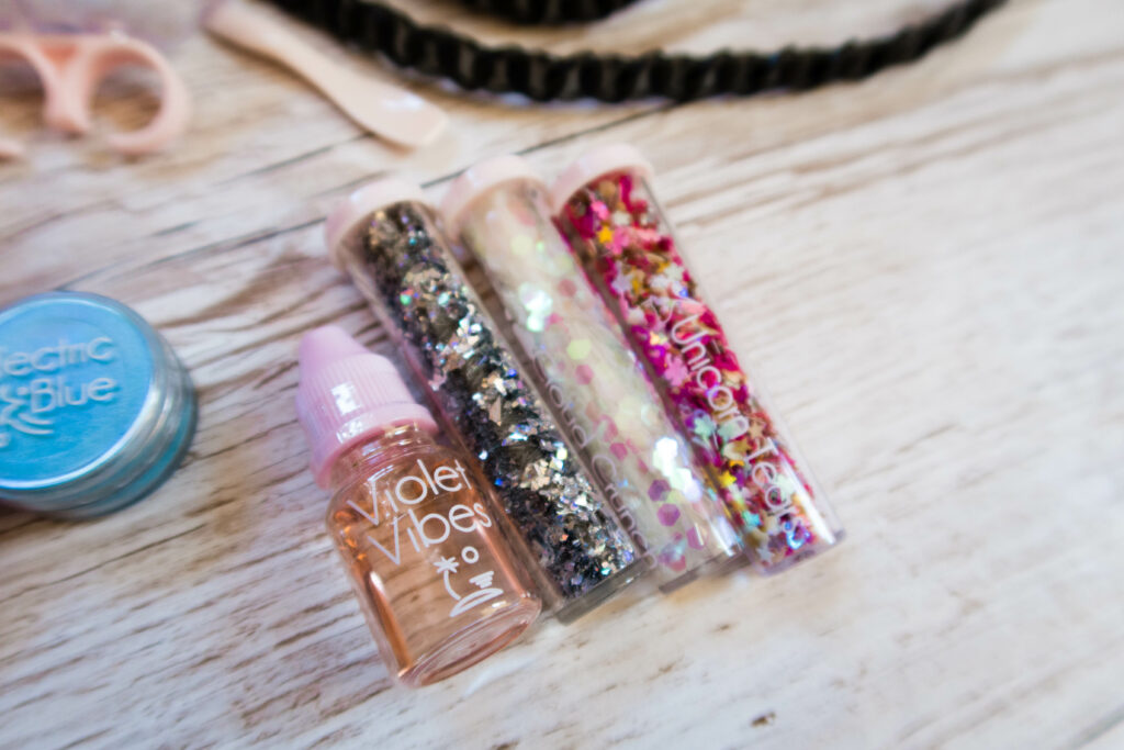 three tubes of different colour glitter and sparkles and scent