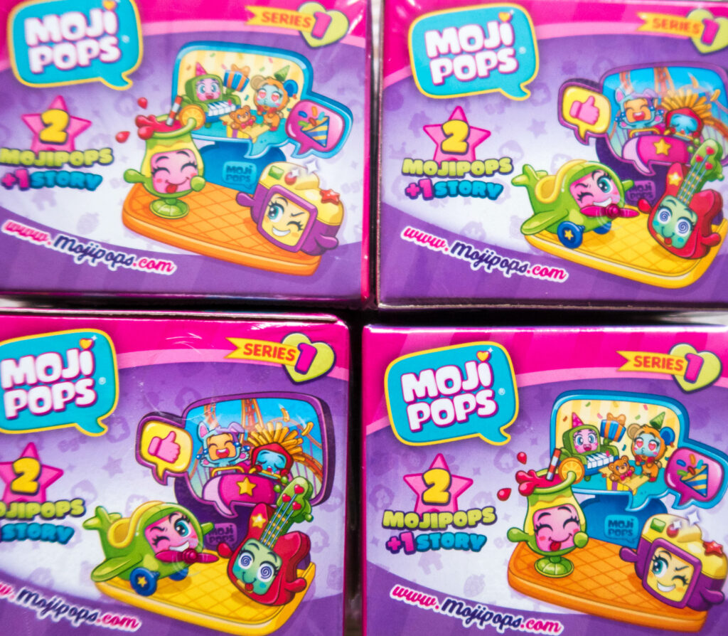 Four double packs of Moji Pops that have a surprise stand in them too