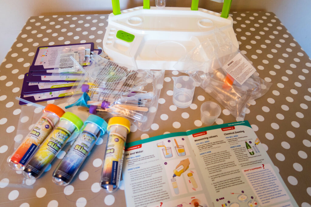 The contents of the chemistry kit laid out on my table, with some of the slime tubes too.
