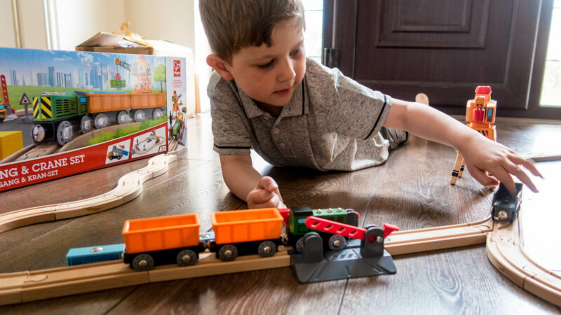 Greg playing with the Crane and Cargo set from Hape