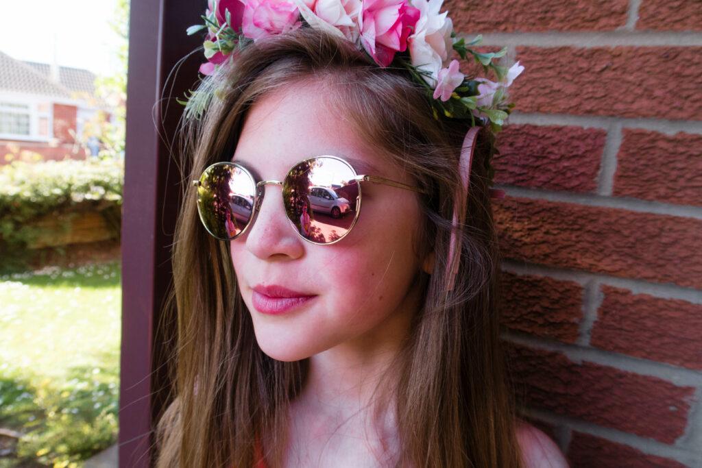 Emma in pink sunglasses