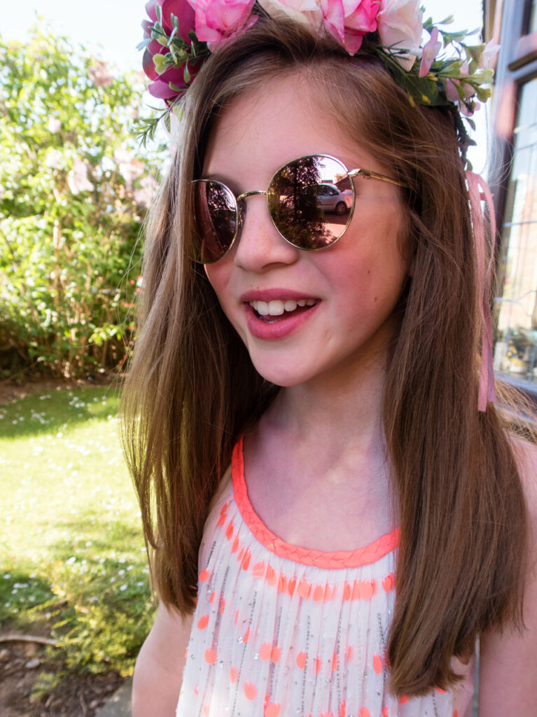 Emma smiling and wearing sunglasses