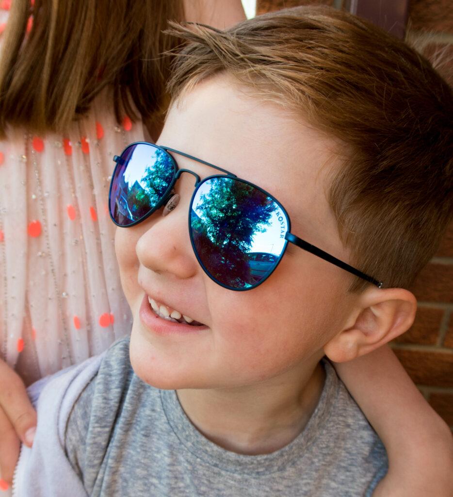 Greg smiling in sunglasses