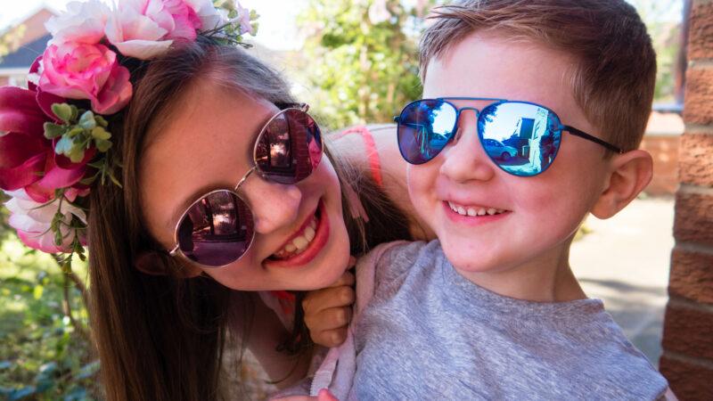 both my children smiling in sunglasses