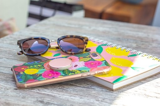 Sunglasses, case, notepad