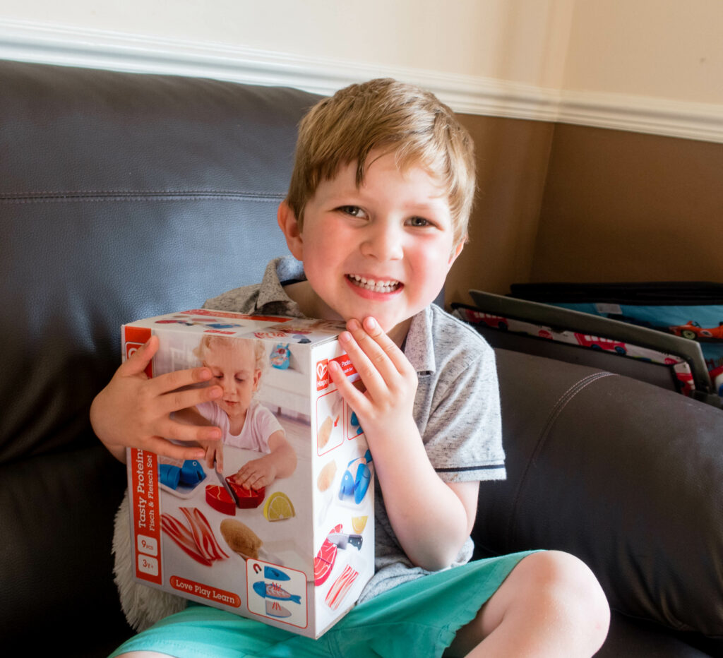 Hape's Tasty Proteins Review Gregory holding the box