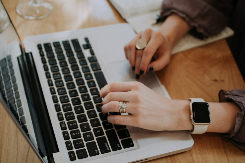 Hnds on a laptop, smartwatch and ring: Time Management Tips for Busy Freelancers