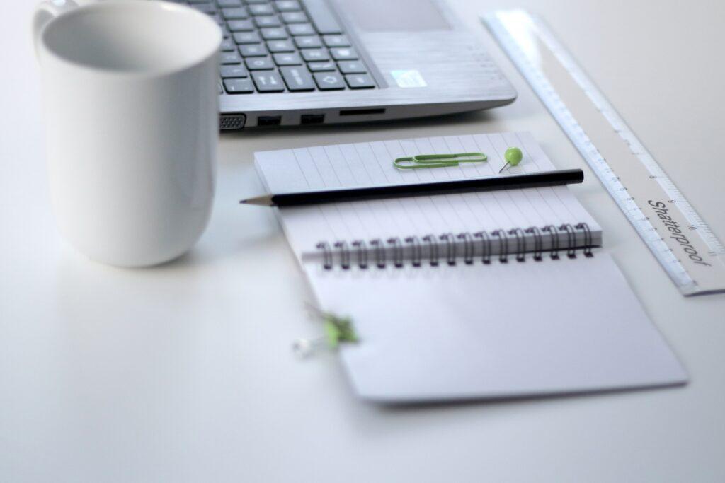 pen paper mug and computer keyboard