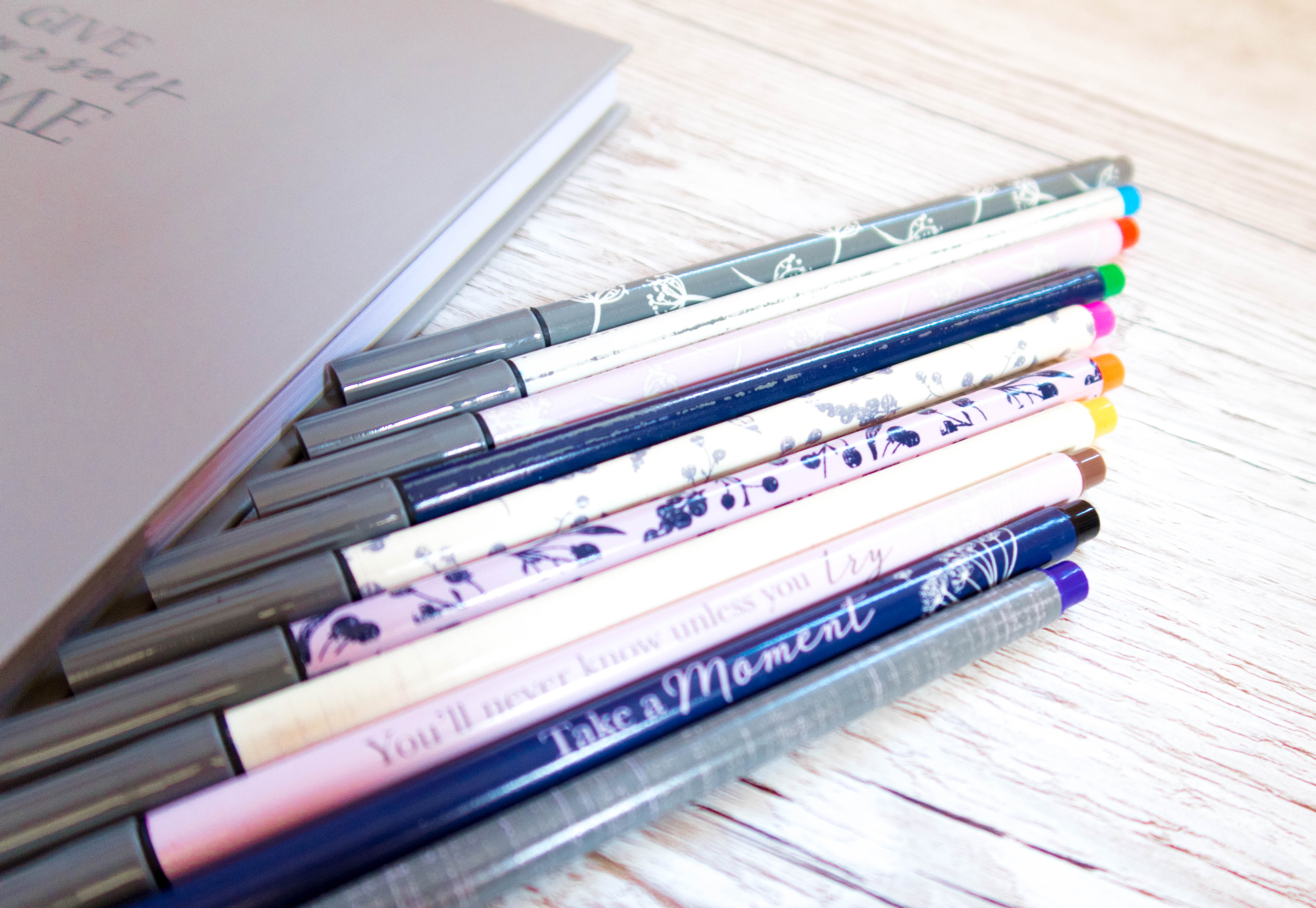 Mindful pens with messages on