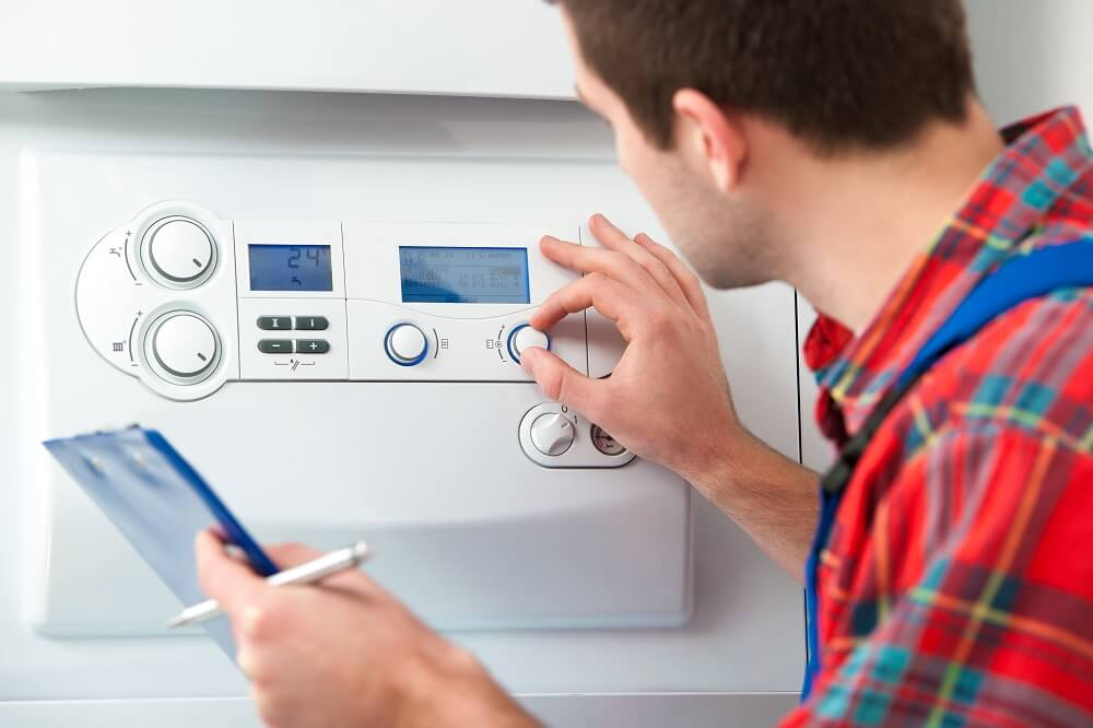 A Simple Boiler Care Plan For The Winter Months man looking at boiler