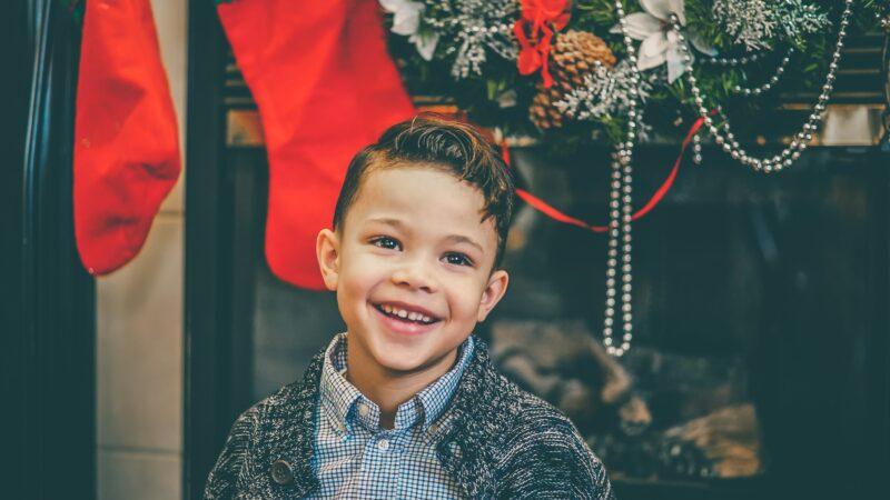 Young boy near a Christmas fireplace